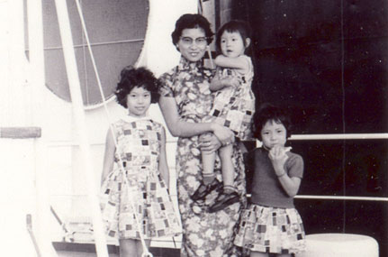 Elaine, her mother, and two sisters aboard the cargo ship that brought them to America.